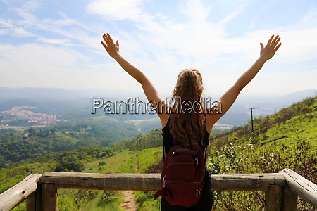hiker woman standing with hands up