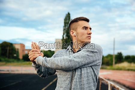 the sportsman doing exercises