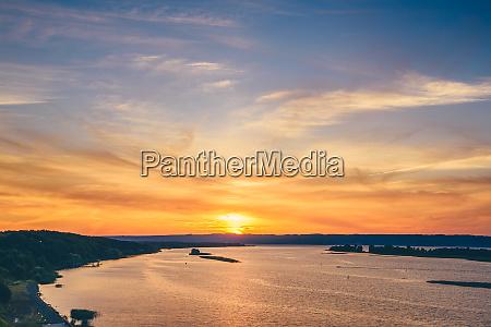 sunset on river shore
