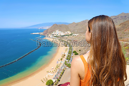 a girl admiring amazing landscape on