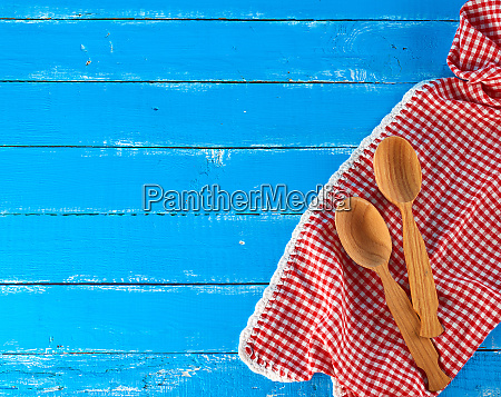 wooden spoon on a red kitchen