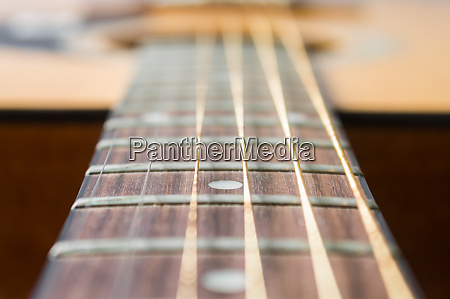 fingerboard and inlay of wood acoustic