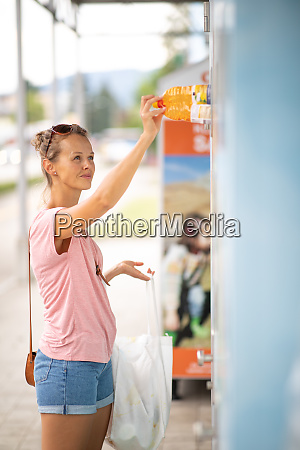wastetrash recycling concept young woman throwing