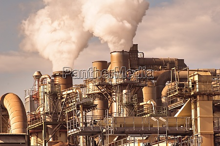 smoking chimneys pipes and silos of