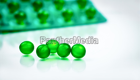 green round soft capsule pills on