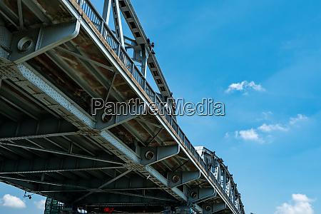 steel bridge structure against blue sky
