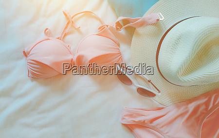 top view of bikini swimsuit sunglasses