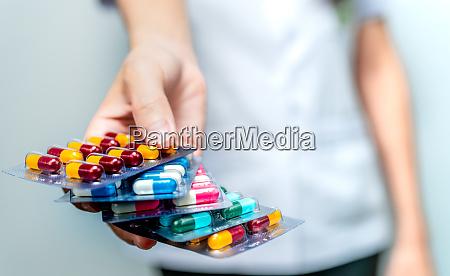 pharmacist or doctor hand holding pack
