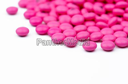 closeup pile of pink round sugar