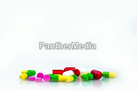 pile of colorful capsule and tablets