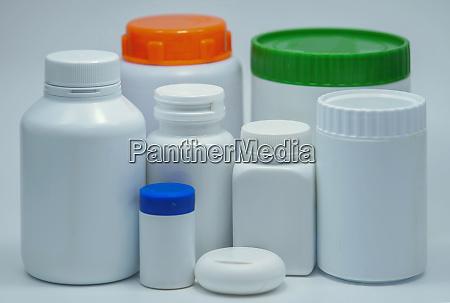 medical white plastic bottle on white