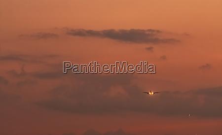 commercial airline passenger plane landing at