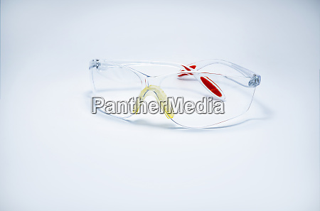 plastic safety glasses isolated on white