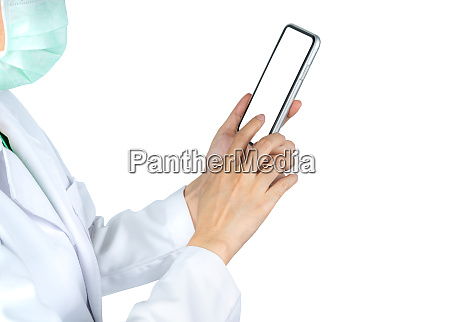 asian doctor use mobile phone to