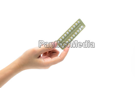 woman hand taking birth control pills