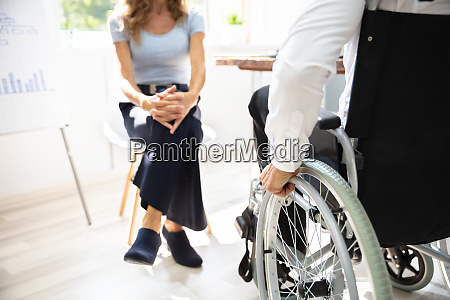 disabled businessman in meeting