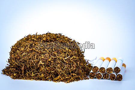 pile of cigarettes and tobacco on