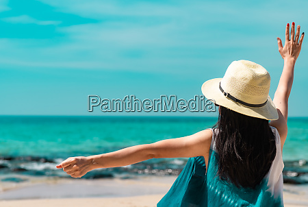 happy young woman wear straw hat