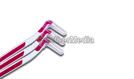 three interdental brush with cover isolated