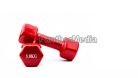 two red dumbbells isolated on white