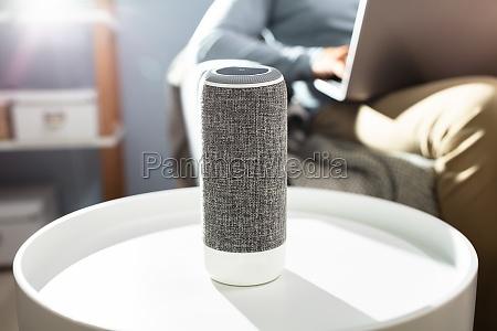 man listening to wireless speaker on