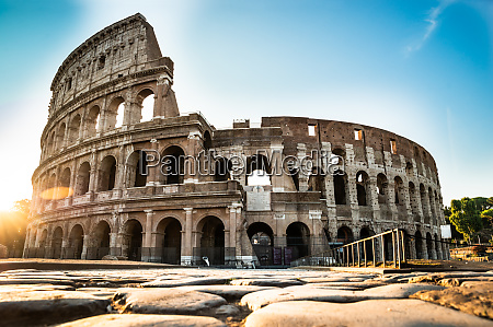 colosseum at sunrise in rome italy