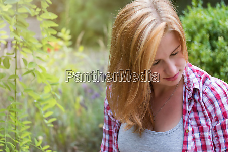 portrait of pensive long haired young