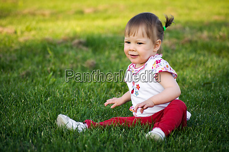 little girl on grass