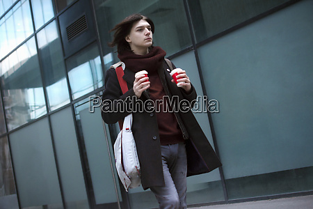 hurrying guy with coffee