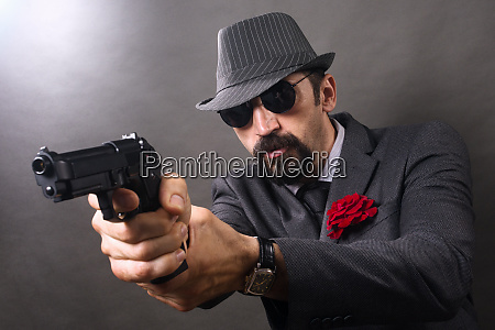 gangster aiming with pistol