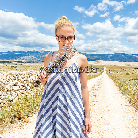 woman in summer dress holding and