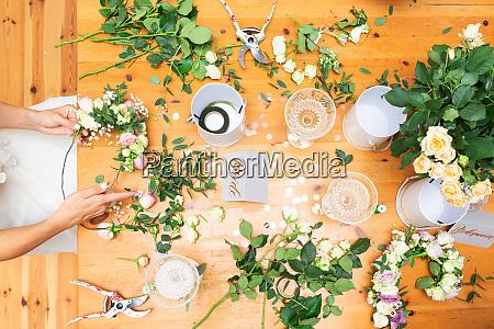 bride and bridesmaids making flower wreaths