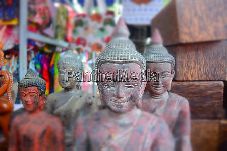 4 red buddha sculptures
