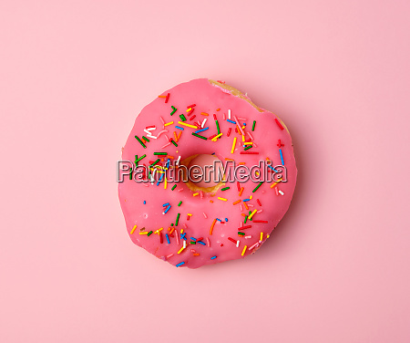 pink round donut with colored sprinkles