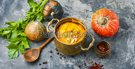 pumpkin soup in a metal pot