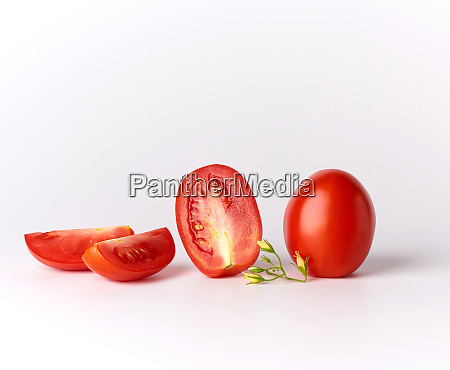 ripe red whole tomatoes and pieces