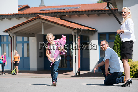 little girl getting out of school