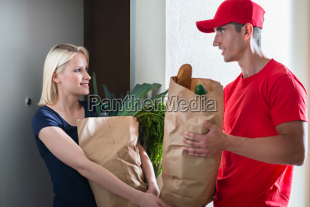 female customer receiving the grocery delivery