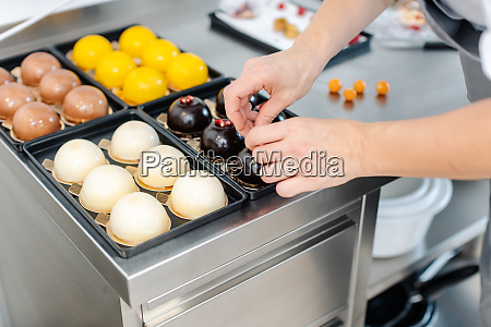 patissier working on little chocolate desserts