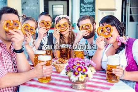 group in bavarian beer garden looking