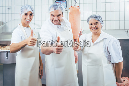 team of butchers showing thumbs up