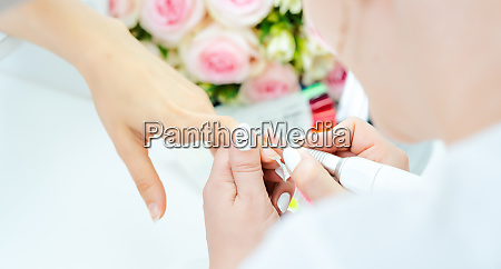 hands of a skilled manicurist working