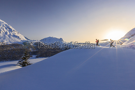 hikers venturing over the frozen lakes