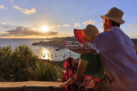 couple look towards english harbour from