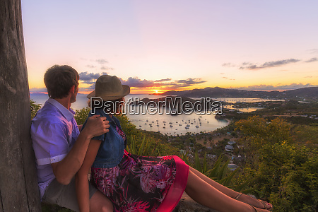 couple look across english harbour from