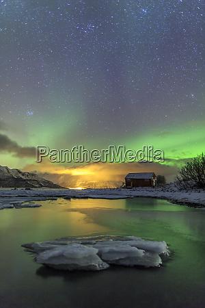 the northern lights illuminates the wooden