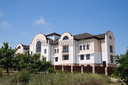 three story hotel mansion with a