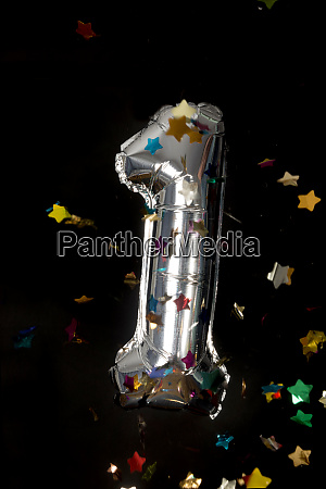 silver balloon and confetti for first