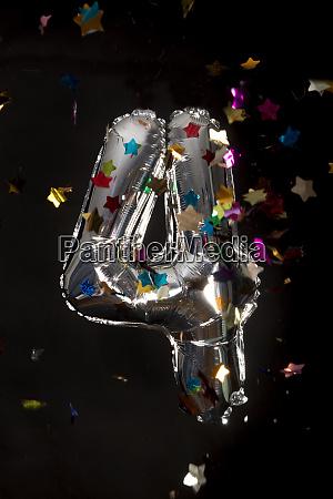 silver balloon and confetti for 4th