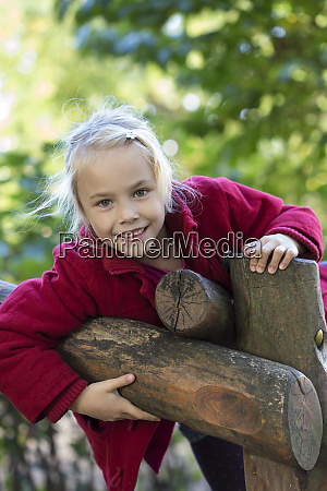 portrait of smiling blond girl in